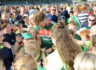 Aidan O'Shea signs autographs for supporters.