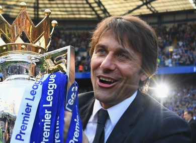 Antonio Conte celebrates with the Premier League title at the end of last season.
