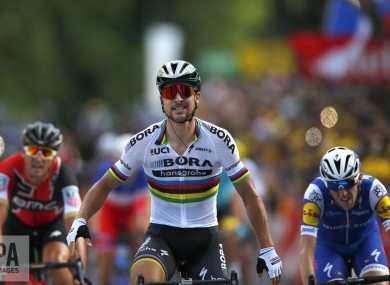 Peter Sagan of Slovakia,, crosses the finish line ahead of Ireland's Daniel Martin, right, and Belgium's Greg van Avermaet.