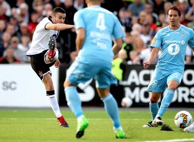 Dundalk's Michael Duffy gets a shot away against Rosenborg.