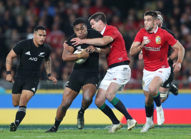 Julian Savea is tackled by Johnny Sexton during the third test between New Zealand and the British & Irish Lions.