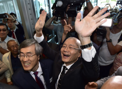 Pastor Hyeon Soo Lim waves to the congregation as he arrives at the Light Presbyterian Church in Mississauga in Ontario yesterday.