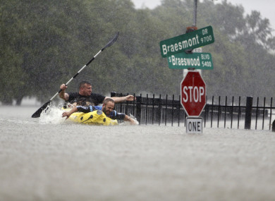 Two kayakers trying to beat the current in Houston