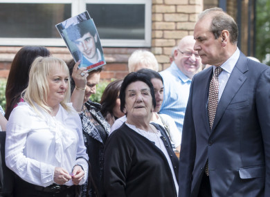 Former West Yorkshire and Merseyside chief constable Sir Norman Bettison (right) walks past Jenny Hicks (left) and other friends and family of victims as he arrives at Warrington Magistrates' Court.