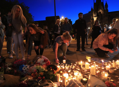 People leave tributes to victims of the Manchester concert bomb attack