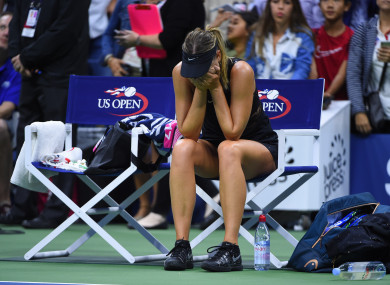 Sharapova reacts to her win over Halep last night.