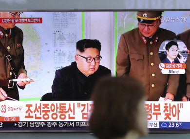 North Korean leader Kim Jong Un is seen on a television in Seoul.
