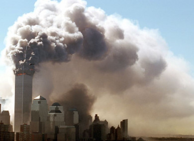 Clouds of smoke rise from the burning upper floors of the World Trade Center in New York on 11 September 2001
