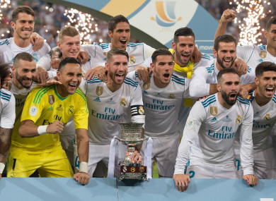 Real Madrid celebrate their Super Cup triumph.