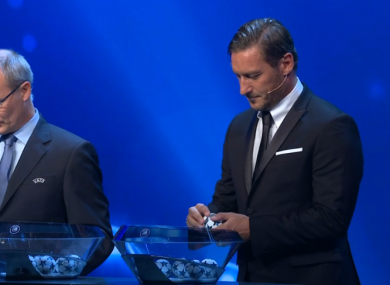 Italian legend Francesco Totti taking part in the draw with Uefa competitions director Giorgio Marchetti.