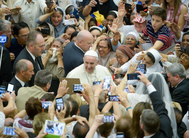Pope Francis is cheered by faithful during his weekly general audience at the Vatican earlier this month.