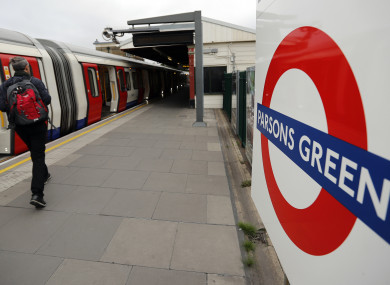 Travellers board the tube at the Parsons Green station.