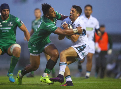Bundee Aki tackles Adam Hastings in Galway.