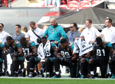 Jacksonville Jaguars players kneel in protest during the national anthem before the NFL International Series match at Wembley Stadium.