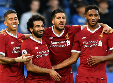 The Liverpool players celebrate Mohamed Salah's goal.