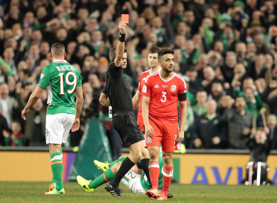 Neil Taylor receiving a red card for his tackle on Seamus Coleman.