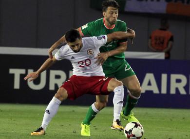 Arter tussles with Georgia's Jambul Jighauri.