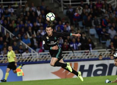 Real Madrid's Gareth Bale scores past Real Sociedad's goalkeeper Tono Ramirez.