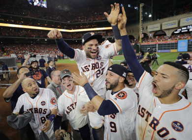 Houston Astros' Jose Altuve is lifted by teammates after Game 7 of baseball's American League Championship Series.