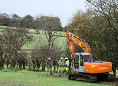 An emergency crew from NI Networks work on a fallen electricity pole in Ballyclare, Co Antrim.