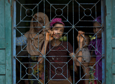 Newly arrived Rohingya Muslims from Myanmar look out from a madrasa window that they used as a shelter in Shahparirdwip, Bangladesh.