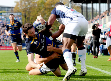 Barry Daly goes over in the corner for Leinster's fourth try.