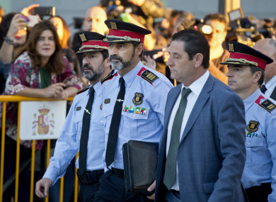 Catalan regional police chief Josep Luis Trapero, second left, arrives at the national court in Madrid, Spain.