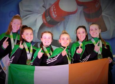 The Irish female taekwondo team celebrate their success.