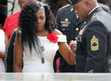 Myeshia Johnson, the wife of Army Sergeant La David Johnson, looks down at his casket during his burial at Fred Hunter's Hollywood Memorial Gardens in Hollywood, Florida.