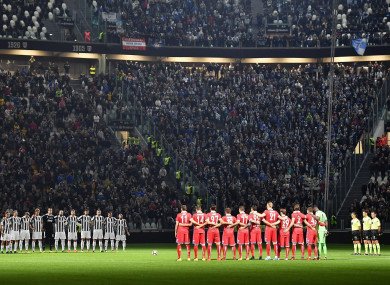Players observe a minute of silence prior to the Serie A soccer match between Juventus and Spal at the Allianz Stadium in Turin.