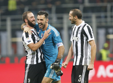 Gonzalo Higuain celebrates with Gianluigi Buffon and Giorgio Chiellini.