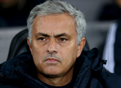 Manchester United manager Jose Mourinho watches on.
