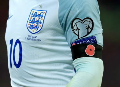 Former England captain Wayne Rooney wearing a poppy armband in 2016.