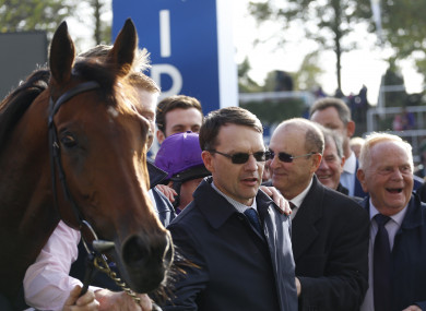 Trainer Aidan O'Brien (centre) after Hydrangea won The QIPCO British Chahamions Fillies & Mares Stakes Race run.