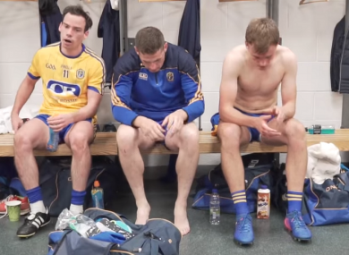 Roscommon players show their disappointment in the dressing room.