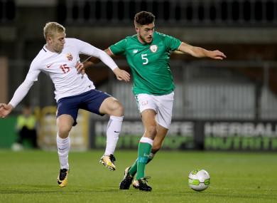 Ireland's Ryan Sweeney with Henrik Bjordal of Norway.