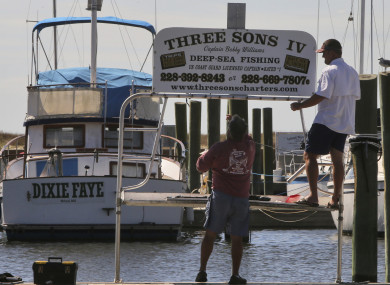 Boat renters take down their sign in Biloxi, Mississippi as residents brace for the arrival of the storm