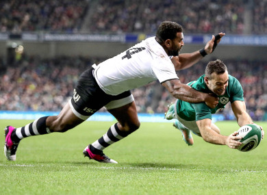 Kearney dives over in the corner for Ireland's second try against Fiji.