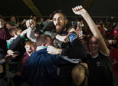 Mark McNulty jumps into the crowd at the shed end to celebrate after Cork's win over Bray last month.