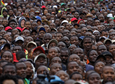 Protesters gather at a demonstration of tens of thousands at Zimbabwe Grounds in Harare, Zimbabwe.