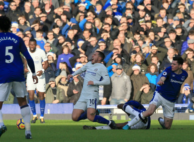 Chelsea's Eden Hazard (centre) reacts after a tackle during the Premier League match at Goodison Park.