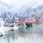 Red bridges and torri gates are striking under a blanket of white snow in the winter months.<span class=