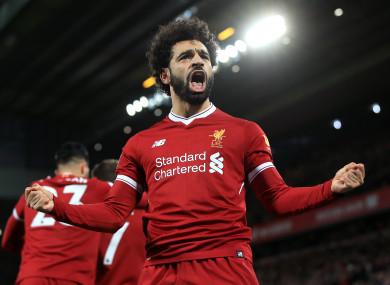 Mo Salah celebrates scoring.