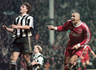 Stan Collymore (R) turns away after scoring the Liverpools 4th and winning goal at Anfield, when they beat the visitors Newcastle United 4-3 in their FA Carling Premiership match at Anfield in 1996.