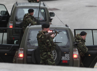 A heavy security presence is seen outside the Special Criminal Court in Dublin for the arrival of Wayne Dundon and associate Nathan Killeen in 2013.