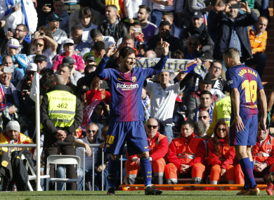 Barcelona's Lionel Messi, left, celebrates after scoring the second goal.