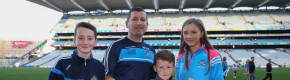 Willy O'Connor pictured alongside his children on the day Dublin Ladies captured the Brendan Martin Cup.
