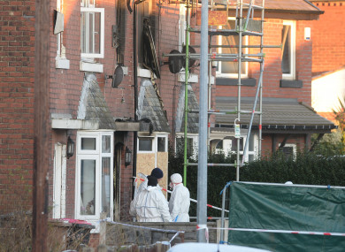 Forensic officers at the scene of the fire.