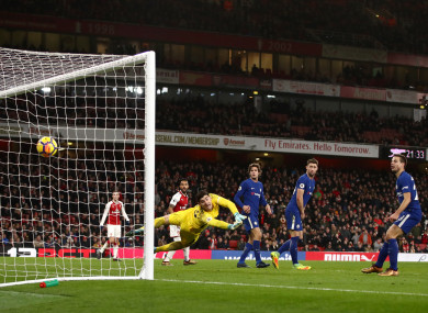 Arsenal's Hector Bellerin (obscured) scores his side's second goal of the game.