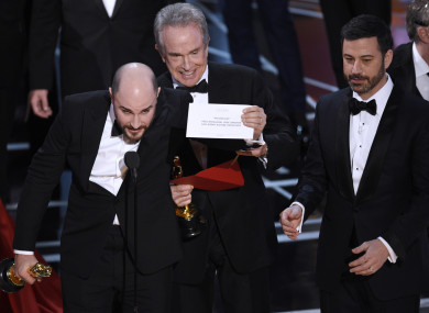 Jordan Horowitz, producer of La La Land, left, shows the envelope revealing